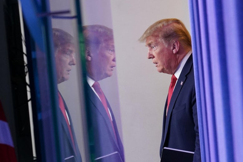 Donald Trump reflected across two screens.