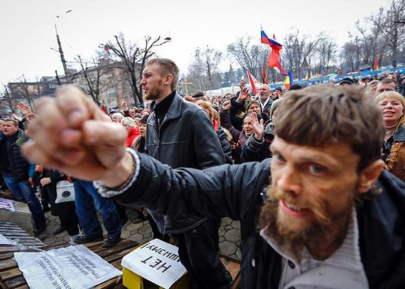 Pro-Russian protesters attend a rally in front of the seized office of the SBU state security service in Luhansk, eastern Ukraine.