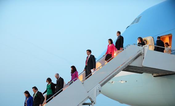 Family members of Newtown shooting victims step off Air Force One with US President Barack Obama (right) upon arrival April 8, 2013 at Andrews Air Force Base in Maryland. The family members traveled to Washington, DC with Obama to lobby for gun control.