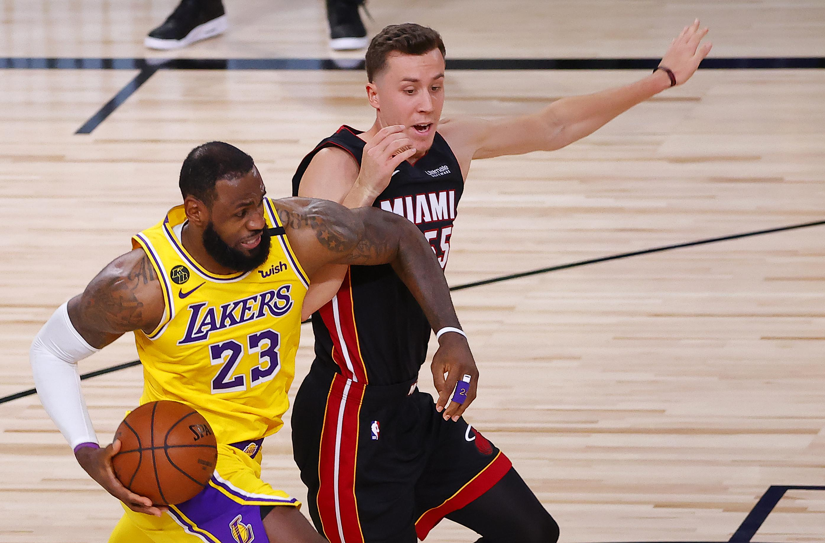 LeBron James drives past Duncan Robinson.