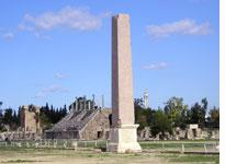 An obelisk at Tyre in the foreground, with a minaret from a modern mosque in the distance (click on image to expand)