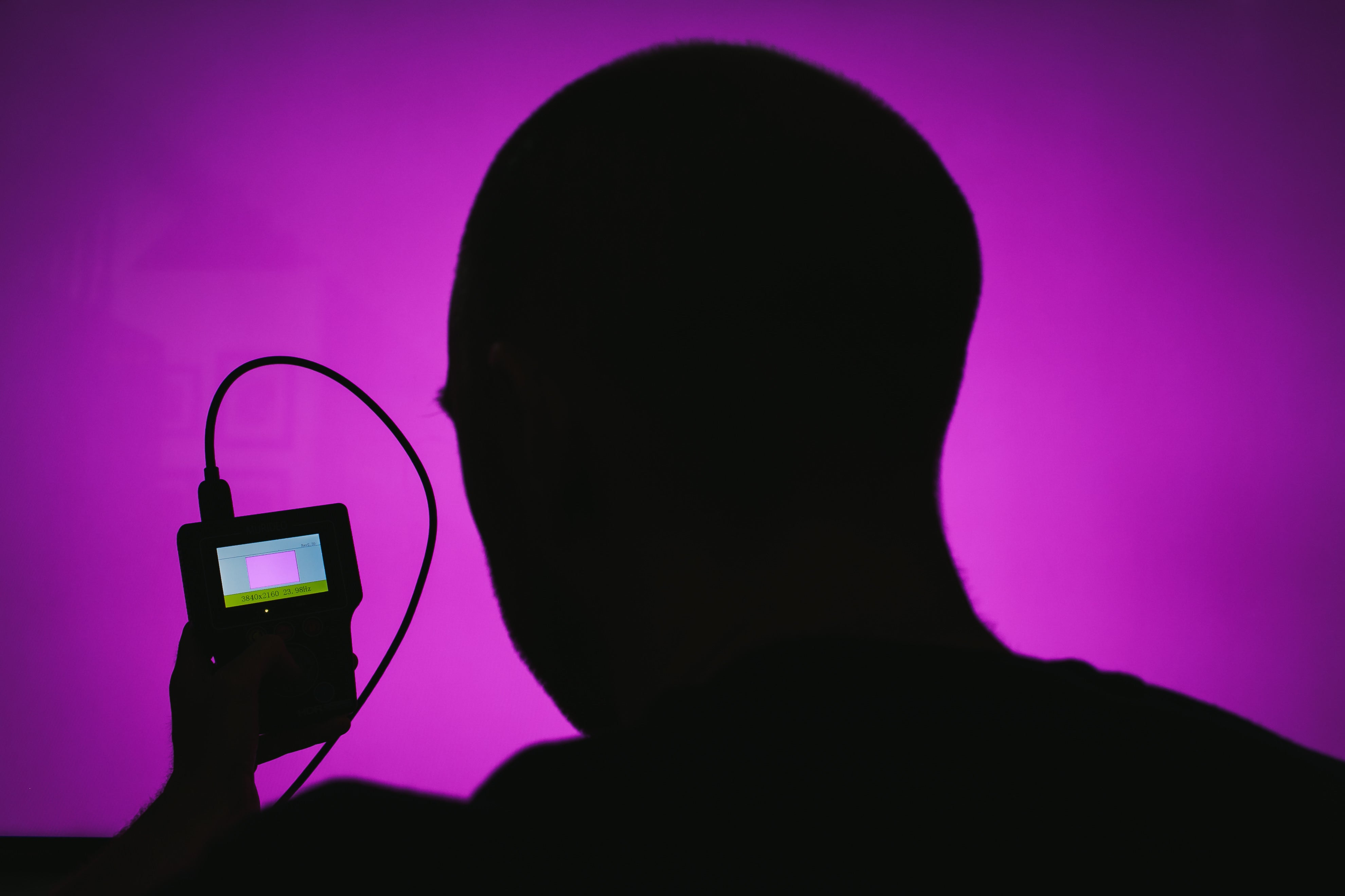 Silhouette of a person using a Murideo Six-G Analyzer.
