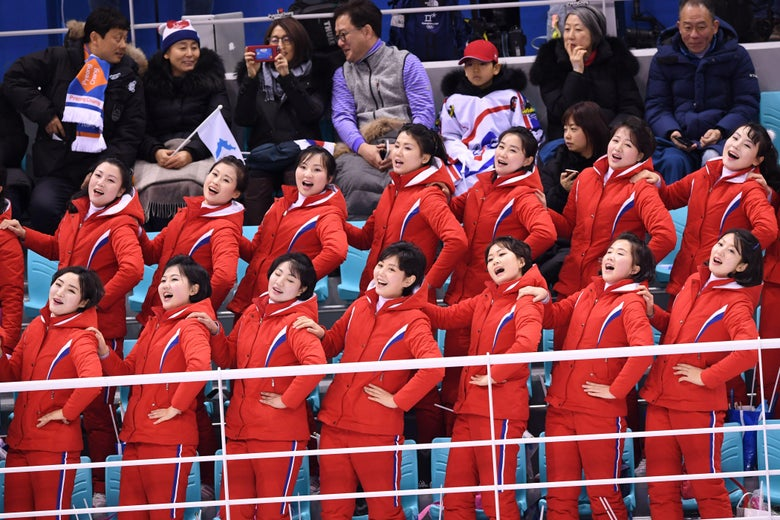 North Korea's cheerleaders cheer during the women's preliminary round ice hockey match between Switzerland and the Unified Korean team during the Pyeongchang 2018 Winter Olympic Games at the Kwandong Hockey Centre in Gangneung on February 10, 2018.   / AFP PHOTO / JUNG Yeon-Je        (Photo credit should read JUNG YEON-JE/AFP/Getty Images)