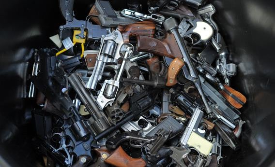 A trash bin full of handguns collected during the LAPD Gun Buyback Program.