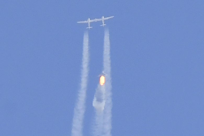 The Virgin Galactic SpaceShipTwo space plane Unity and mothership separate as they fly way above Spaceport America, near Truth and Consequences, New Mexico on July 11, 2021 on the way to the cosmos.