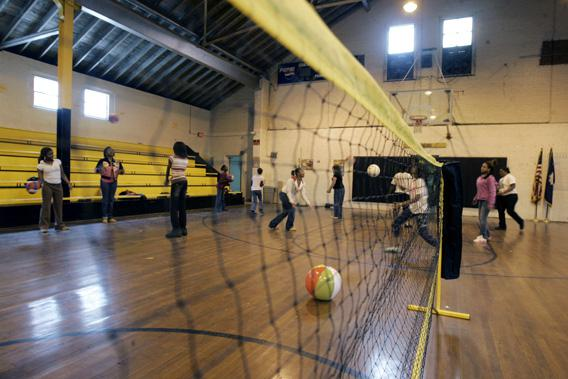 Students play in the school gym which is over seventy years old and has a roof that leaks at J.V. Junior High School in Dillon, South Carolina.