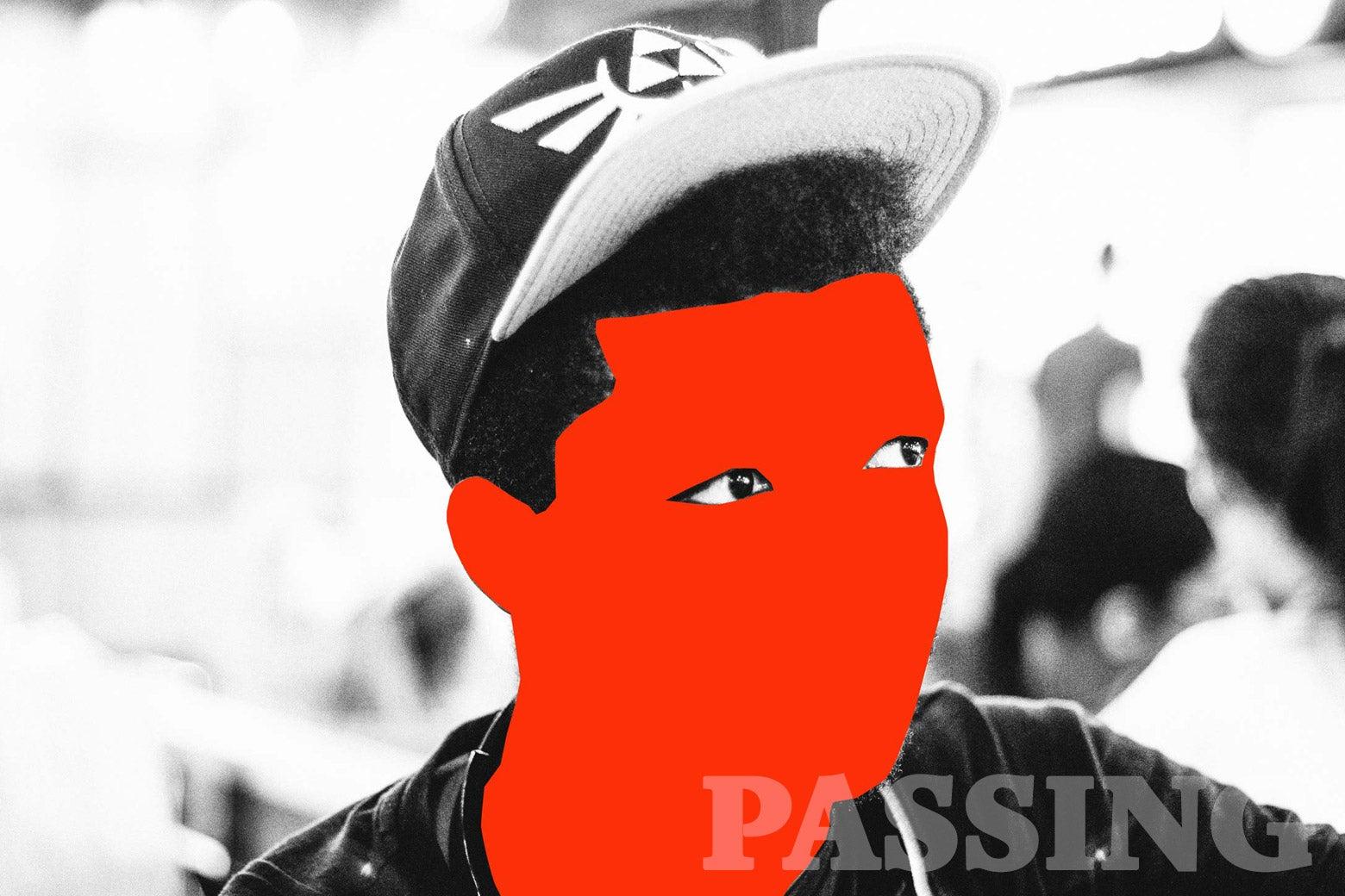 A young black man wearing a baseball hat.