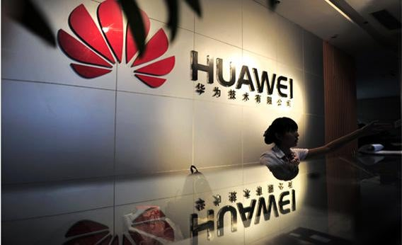 A receptionist sits behind the counter at the Huawei office.