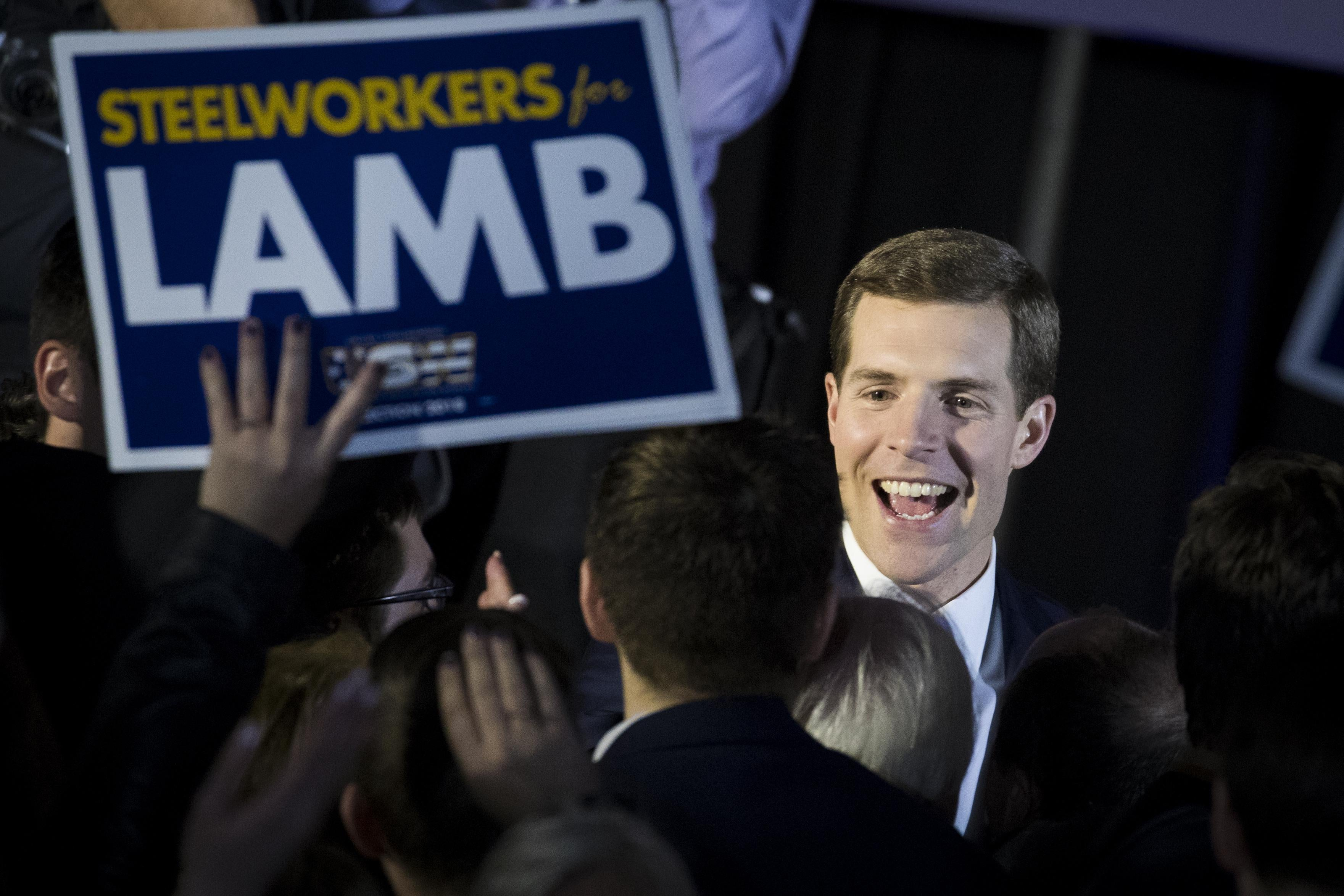 Conor Lamb greets supporters at an election night rally in March.