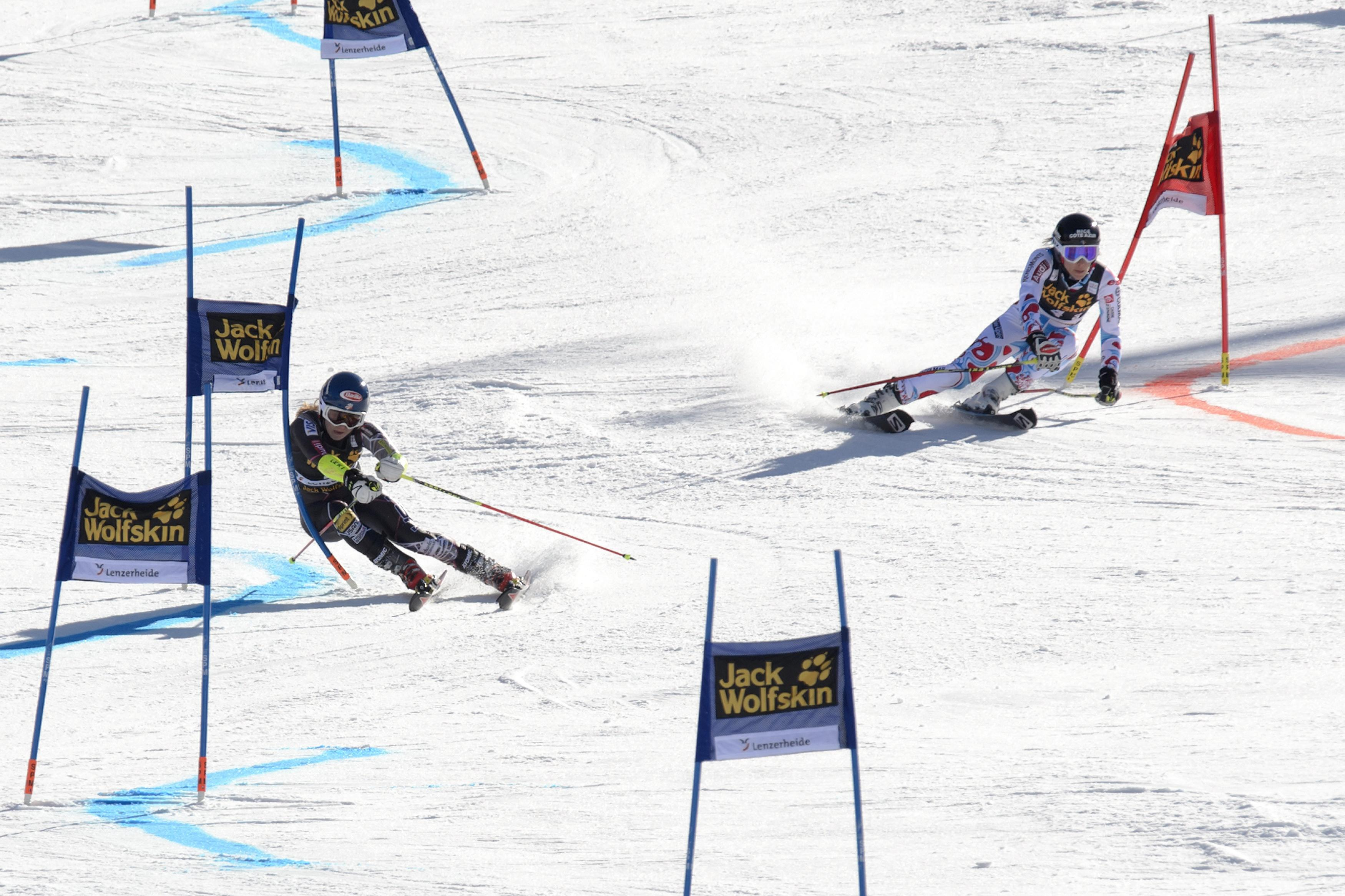 US Mikaela Shiffrin (L) competes with France's Nastasia Noens during the nation team event at the Alpine Skiing World Cup finals on March 14, 2014 in Lenzerheide. Switzerland beat the United States to win the mixed team event at the World Cup finals on home snow at Lenzerheide.   AFP PHOTO / FABRICE COFFRINI        (Photo credit should read FABRICE COFFRINI/AFP/Getty Images)