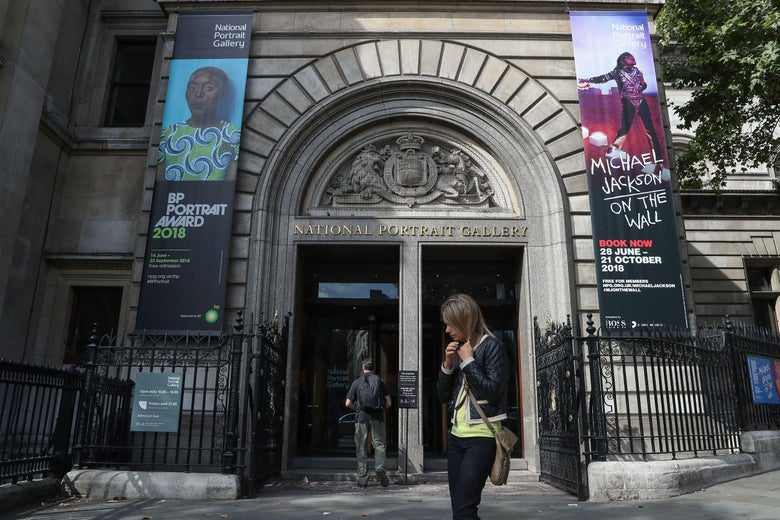 Pedestrians walk past the entrance to the National Portrait Gallery in central London on Aug. 24, 2018.