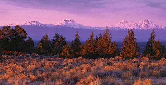 Sunset over Oregon's Three Sisters Volcanoes.