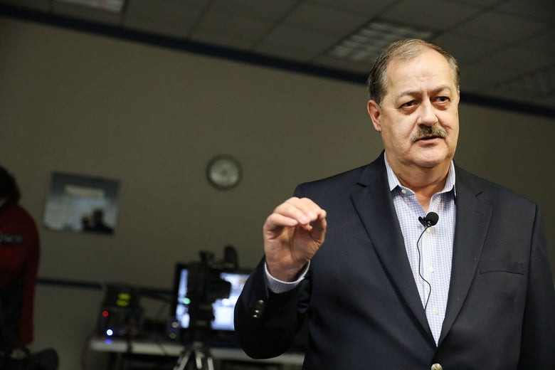 Don Blankenship speaks while wearing a microphone on his lapel.