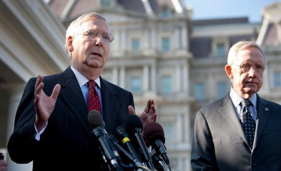 Senate Minority Leader Mitch McConnell (R-KY), accompanied by Senate Majority Leader Harry Reid.