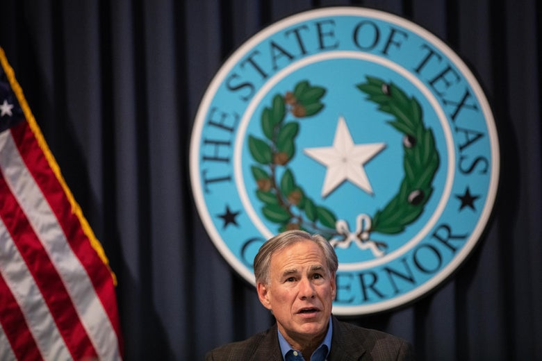 Greg Abbott speaks in front of the Texas states seal.
