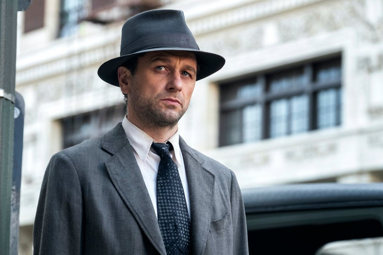 Matthew Rhys wearing a fedora in a still from Perry Mason.