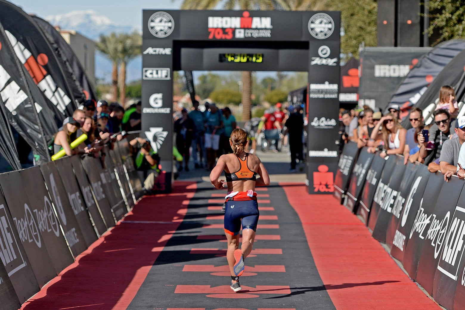 A woman runs toward the finish line at the Ironman 70.3 Indian Wells La Quinta on Dec. 9 in California.