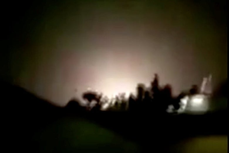 Blurry image of explosion at al-Asad air base.