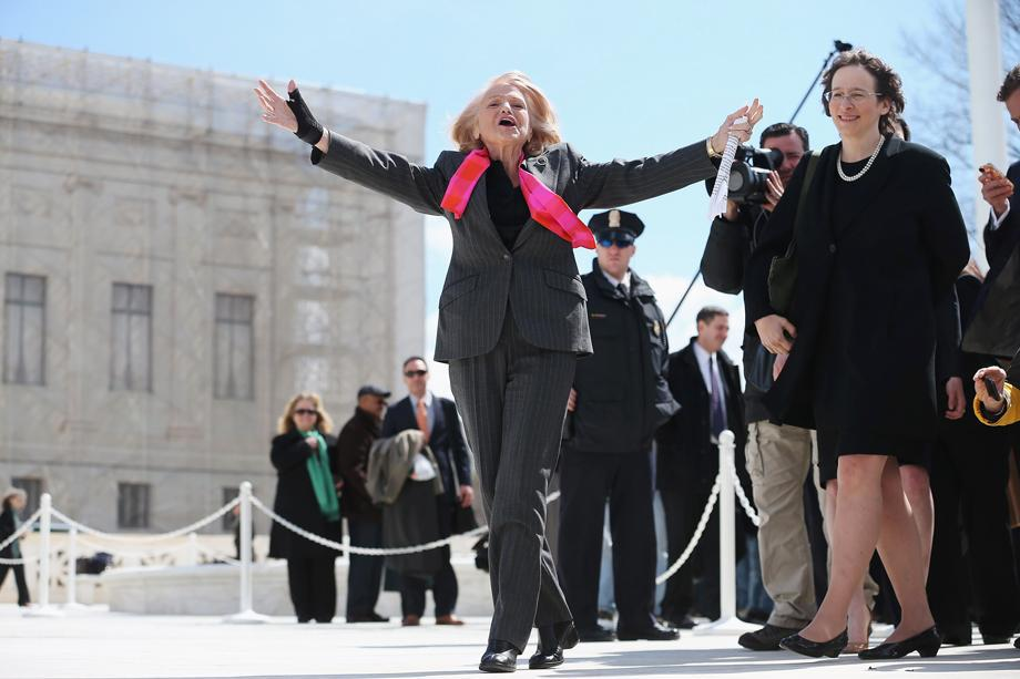 Edith Windsor, the 83-year-old plaintiff in the case challenging the Defense of Marriage Act, acknowledges her supporters as she leaves the Supreme Court, March 27, 2013 in Washington, D.C.