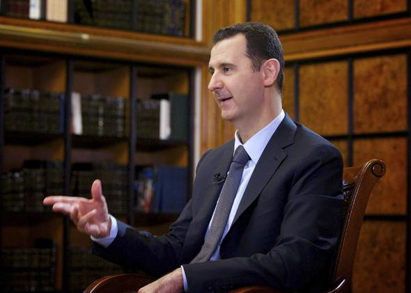 Syria's President Bashar al-Assad speaks during an interview with Russian state television RU24 in Damascus.
