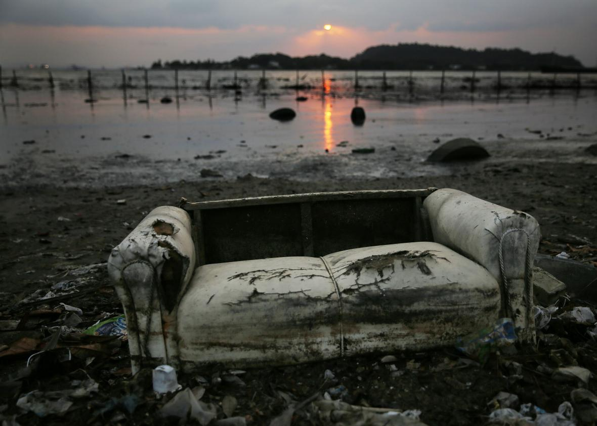 A Couch Rests Among Pollution Along The Edge Of Guanabara Bay, The Venue  For The Olympic Sailing, On Aug. 2 In Niterói, Brazil.