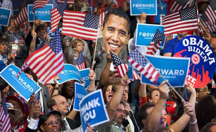 A DNC attendee waves an Obama-shaped sign as the President speaks.