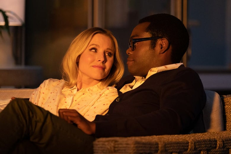 Chidi and Eleanor sit on the couch, staring lovingly into each other's eyes, in the light of the golden hour