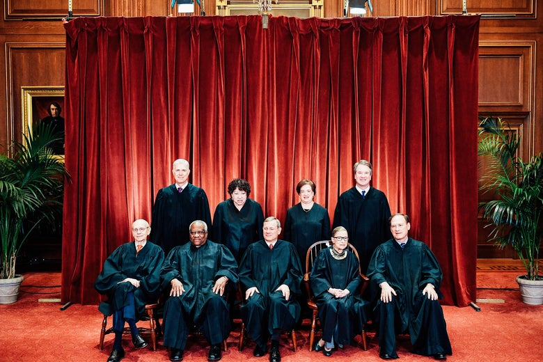 Justices of the Supreme Court pose for their official photo.