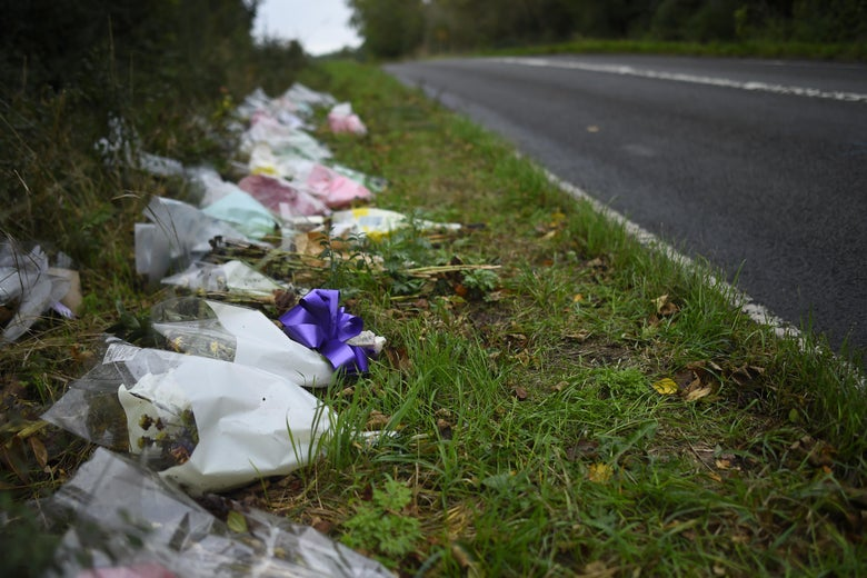 Flowers left roadside in remembrance of Harry Dunn