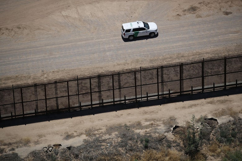 A U.S. Border Patrol vehicle is seen along the U.S./Mexico border fence on June 19, 2018 in Tornillo, Texas.