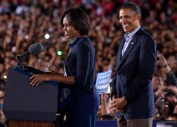 US President Barack Obama listens as First Lady Michelle Obama at a rally in Columbus, Ohio. Click image to expand.