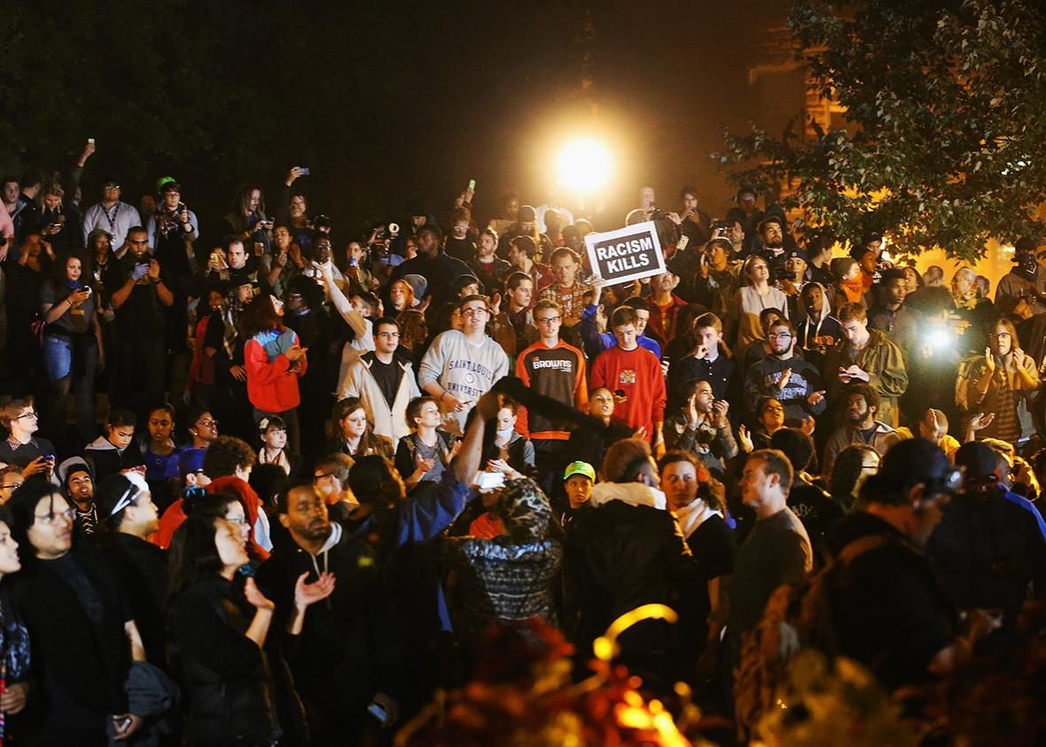 Demonstrators listen to speakers during a rally on the campus of Saint Louis University on October 13, 2014 in St Louis, Missouri.