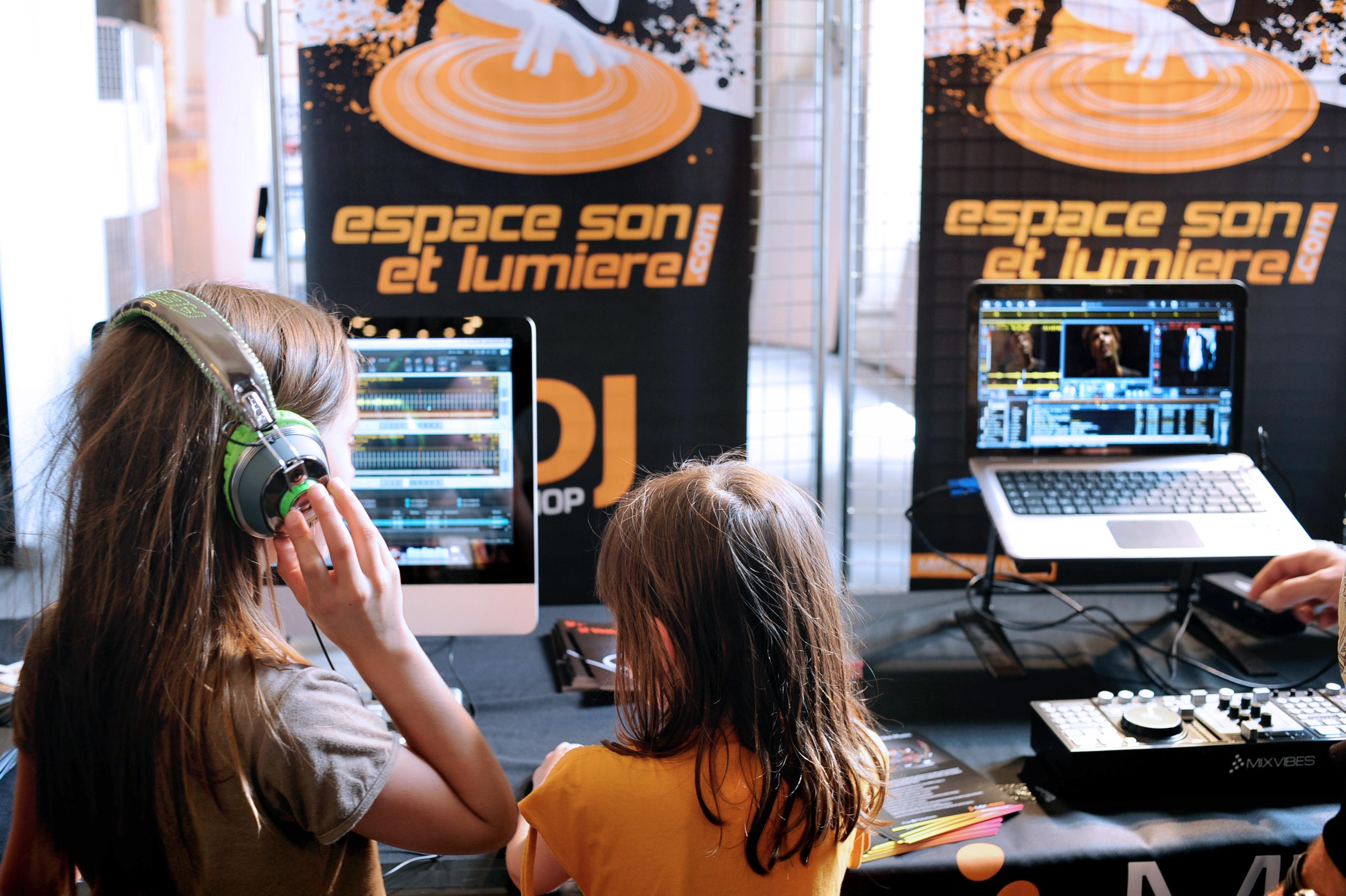 Children learn to mix electronic music on June 3, 2011 during the 'Mini sonore', a workshop for children between 4 and 10 years, as part of the 'Nuits Sonores' (The nights of sounds) electronic music Festival in Lyon, eastern France.