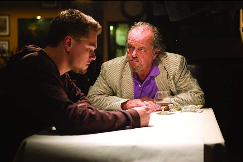 Leonardo DiCaprio and Jack Nicholson sit at a table.