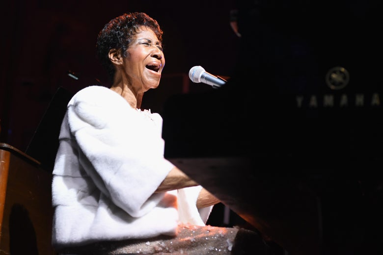Aretha Franklin performs onstage.