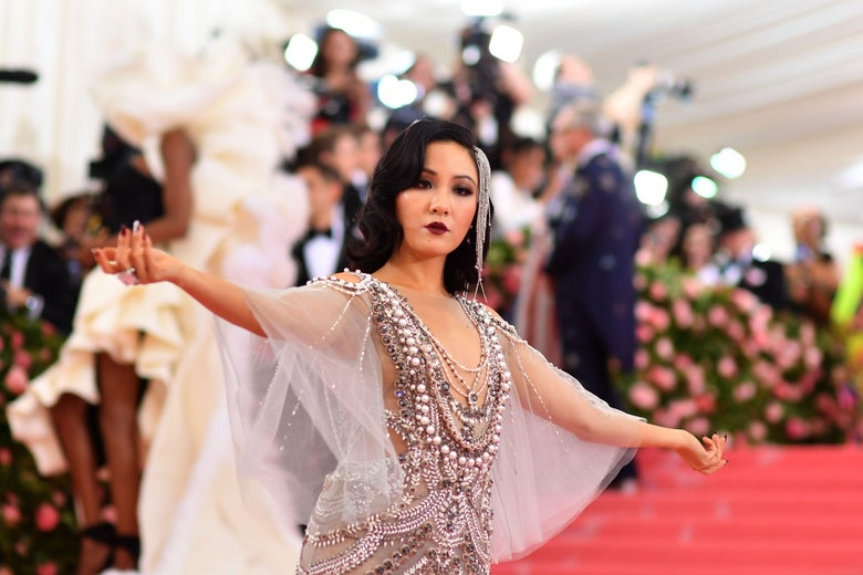 Constance Wu at the 2019 Met Gala, holding out both hands.
