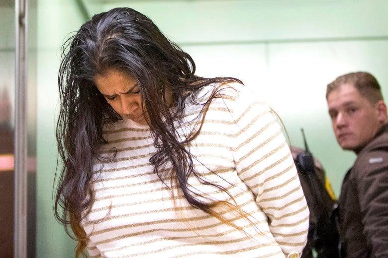 Purvi Patel looks down as she walks past.