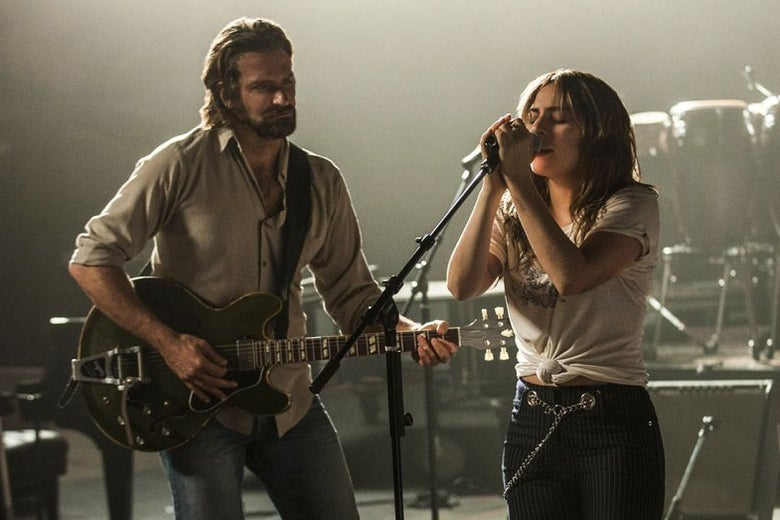 Bradley Cooper and Lady Gaga performing on stage in A Star Is Born
