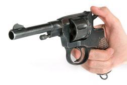 Man holding a pistol.