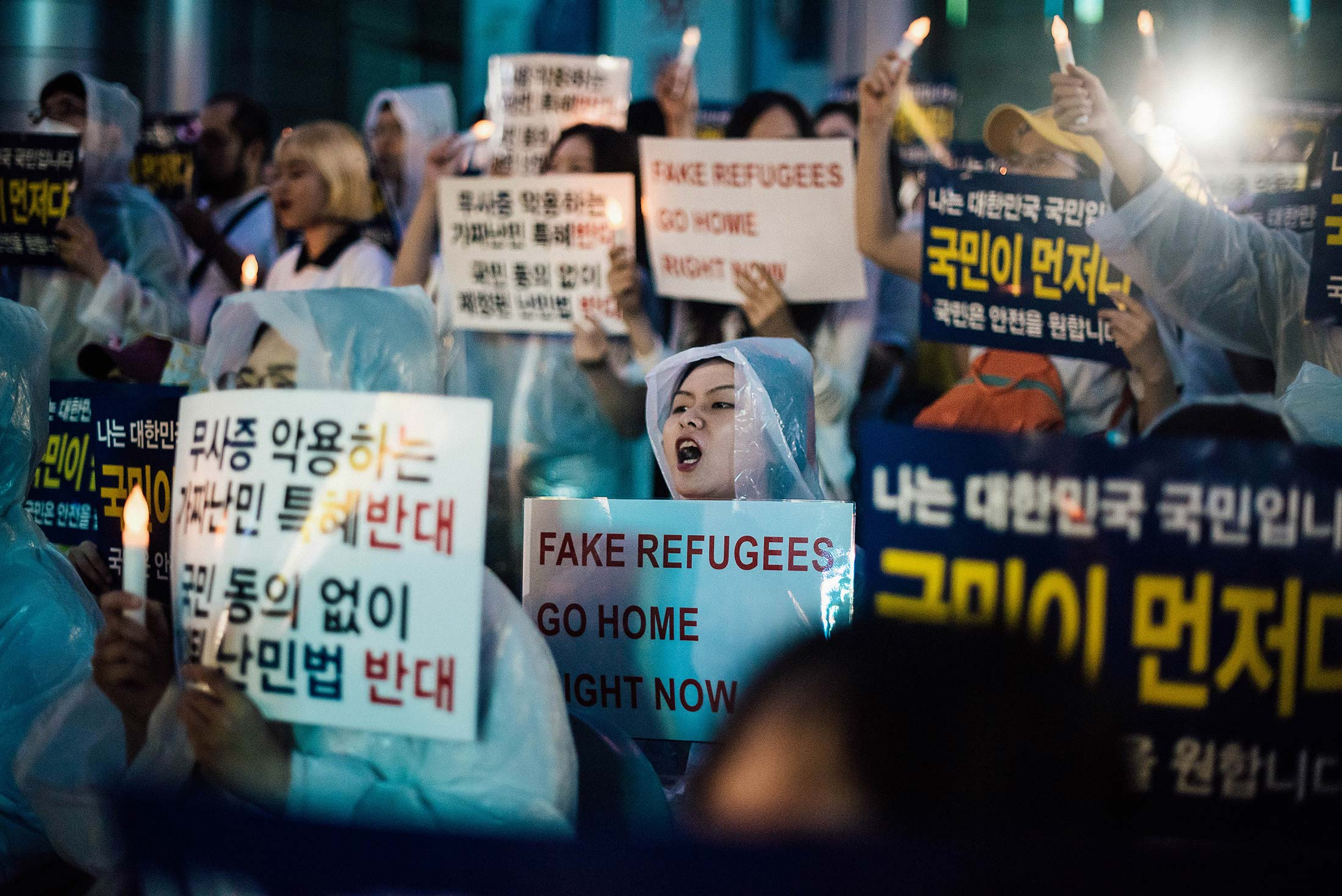 Anti-immigration activists attend a protest against a group of asylum-seekers from Yemen.