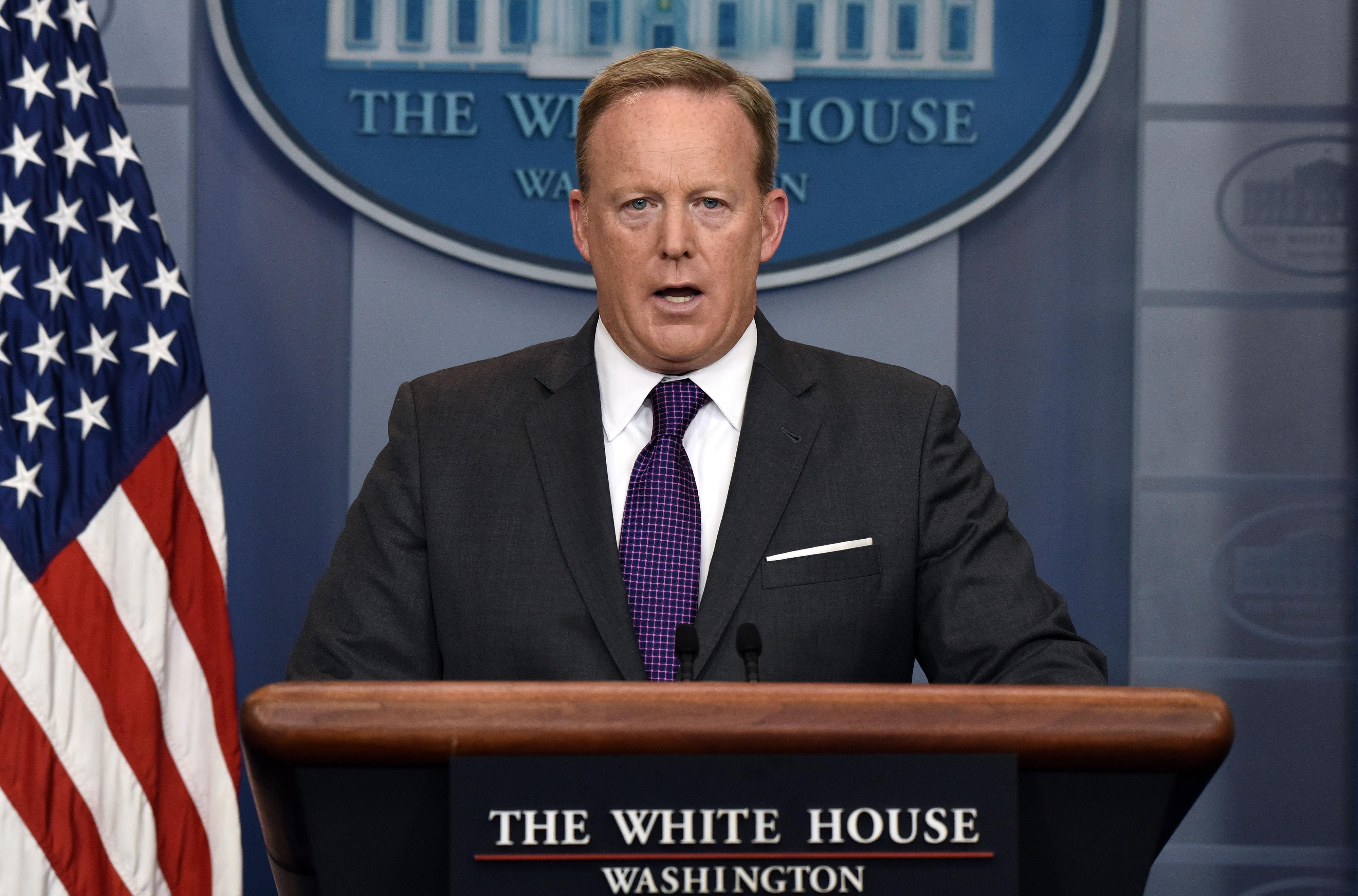 Then-White House Press Secretary Sean Spicer at the podium delivering the daily briefing at the White House on July 17, 2017 in Washington, DC.