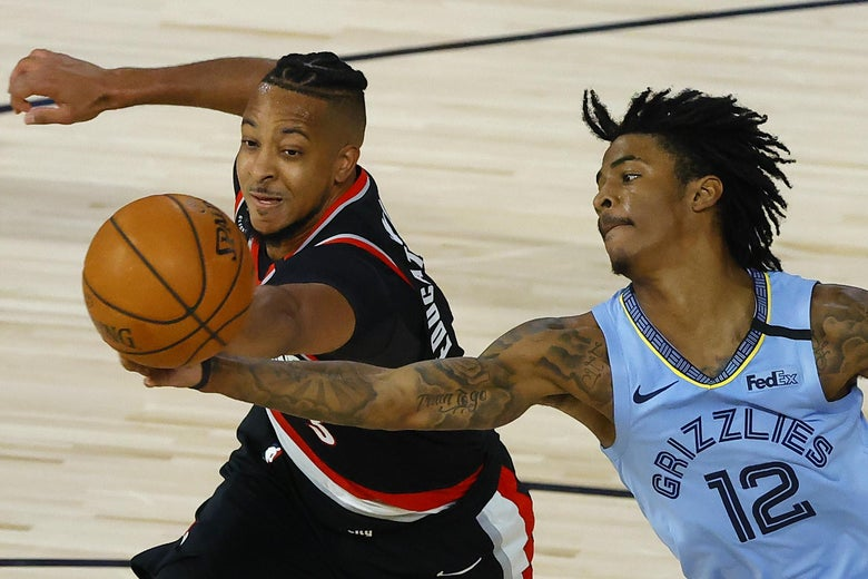 LAKE BUENA VISTA, FLORIDA - AUGUST 15: CJ McCollum #3 of the Portland Trail Blazers and Ja Morant #12 of the Memphis Grizzlies go after a rebound during the fourth quarter in the Western Conference play-in game one at The Field House at ESPN Wide World Of Sports Complex on August 15, 2020 in Lake Buena Vista, Florida. (Photo by Kevin C. Cox/Getty Images)