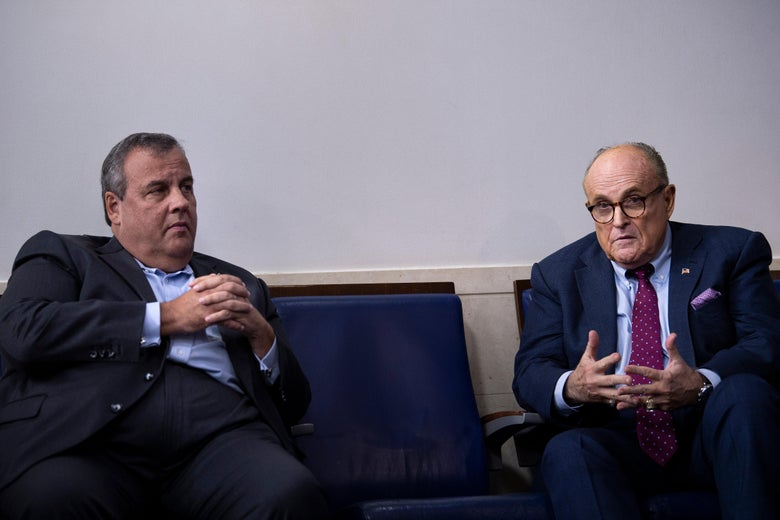 Former New Jersey Governor Chris Christie listens while former New York City Mayor Rudy Giuliani speaks during a briefing at the White House September 27, 2020, in Washington, D.C.