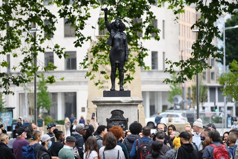 People gather to view a new sculpture, by local artist Marc Quinn, of Black Lives Matter protestor Jen Reid. on the plinth where the Edward Colston statue used to stand on July 15, 2020 in Bristol, England.