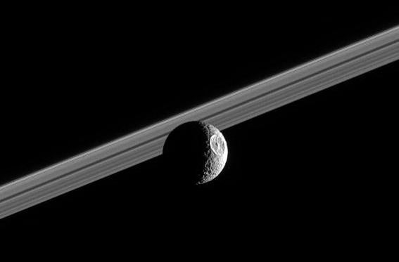 Saturn's moon Mimas, with the rings in the background.