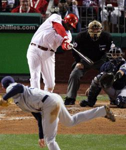 Ryan Howard of the Philadelphia Phillies hits a three-run home run. Click image to expand.