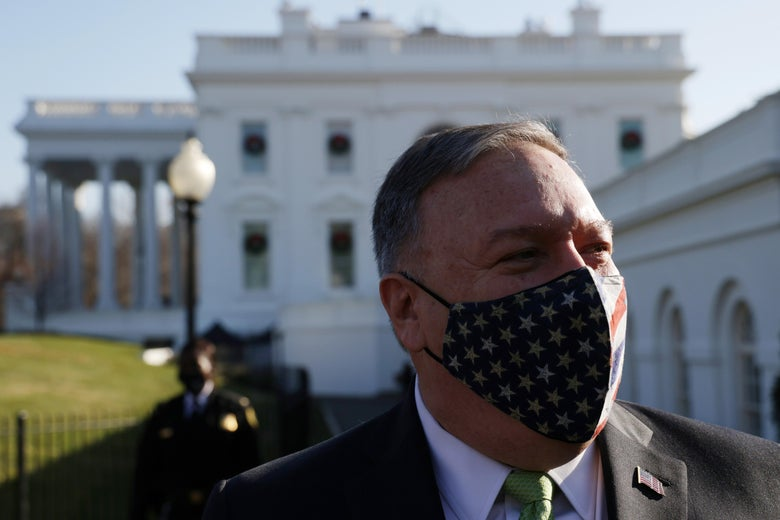 Mike Pompeo wears a stars-and-stripes mask while standing in front of the White House.