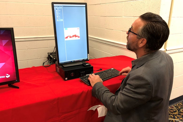Eric Coomer, director of product strategy for Dominion Voting Systems, demonstrates one of the company's voting machines, in Harrisburg, Pennsylvania on April 26, 2018.