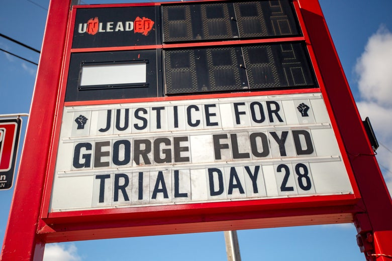 A defunct gas station sign reads JUSTICE FOR GEORGE TRIAL DAY 28.