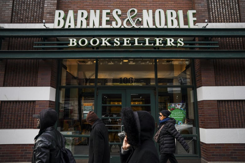 People walk by a Barnes & Noble bookstore.